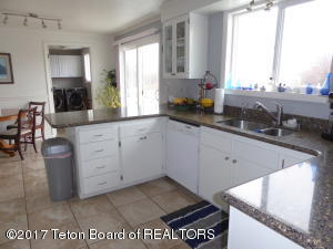 Kitchen has solid surface countertops
